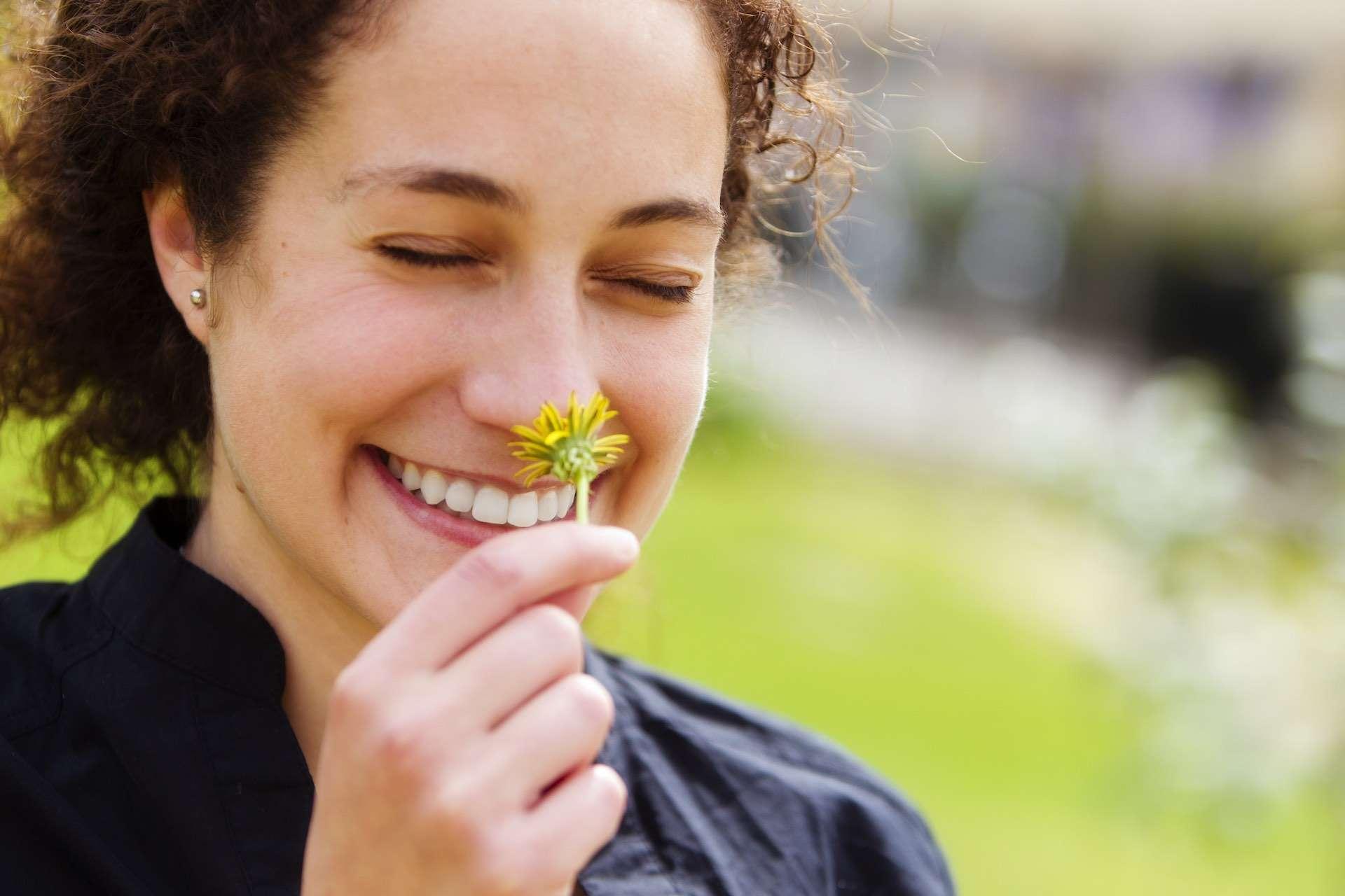woman finding beauty in flower
